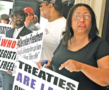 Marilyn Vann protests during last year's Sovereignty Symposium in Oklahoma City.  AP FILE PHOTO