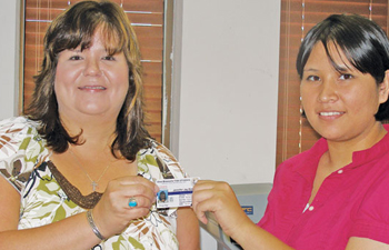Otoe-Missouria Tribal Member Jennifer Kessel of Somerville, NJ (left) receives her CDIB card from Enrollment Clerk Walterene Hare. Kessel was the first member to enroll after the historic amendment passed in June 2009. PHOTO COURTESY HEATHER SARLES