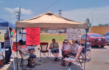 COURTESY  Apache tribal citizens sit Tuesday, June 21, 2011, in front of the regional Bureau of Indian Affairs office in Anadarko .