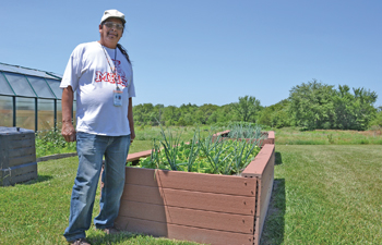 Eddie Joe Mitchell stands in the Prairie Band Potawatomi Nation's traditional garden this summer. COURTESY PHOTO