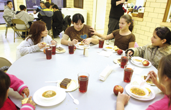 In this 2009 photo, Oaks Indian Mission residents enjoy an evening meal together in the mission's cafeteria.  PHOTO COURTESY CHEROKEE PHOENIX